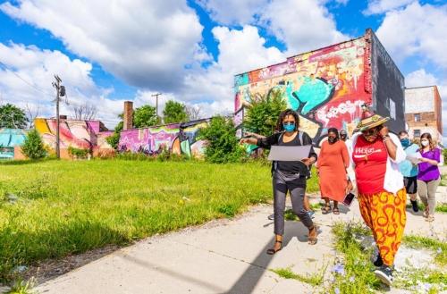 Photo of DJDS team walking the Love Campus site by Stephanie Kamera